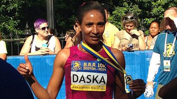 Raw Video: Mamitu Daska of Ethiopia Wok 2014 B.A.A. 10K In Boston