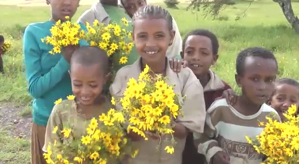 Happy children with Meskel Flowers