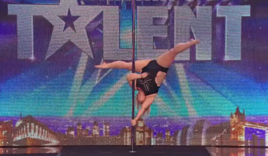 A Pole Dancing - Plus-Sized Girl Steps On Stage