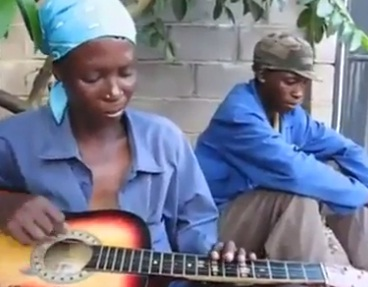 Can you play the guitar like this woman? Very strange skill