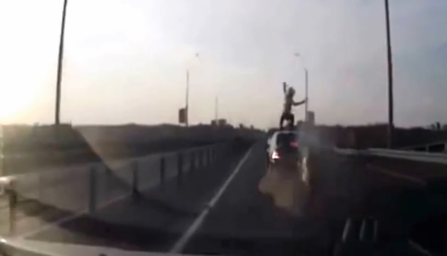 Motorcycle crash rider lands on feet on top of car!